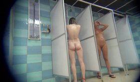 Two hot girls showering together shamelessly
