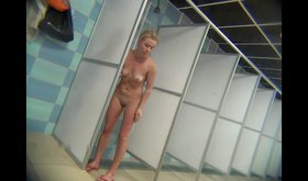Blond-haired swimmer takes a shower totally naked in this voyeur vid