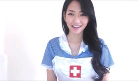 Naughty Asian nurse MissReinaT masturbating furiously on the floor