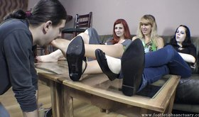 Three femdom girlfriends shoving their feet in this guy's face