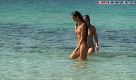 Shy skinny girl removes her bikini on a nude beach