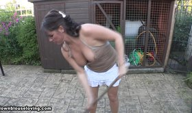 Tanned brunette doing chores and showing her tits
