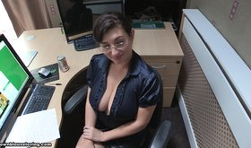 Busty mature lady exposing her breasts in a blouse