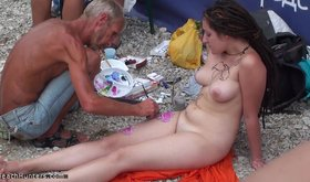 Naked chick gets her body painted by an old guy
