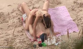 Dark-haired hottie rides her boyfriend on a beach