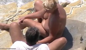 Chubby blonde blows a big-dicked older guy on camera