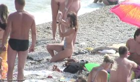 Topless girlfriends looking really hot on a beach