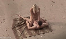 Amateur couple enjoying passionate sex among the sand